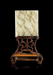 A WHITE JADE PLAQUE WITH FLOWERS