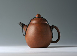 AN YIXING STONEWARE TEAPOT AND COVER