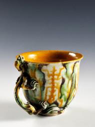 A SANCAI-GLAZED CUP WITH A DRAGON-HANDLE