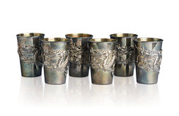 A SET OF SIX EXPORT SILVER WINE CUPS