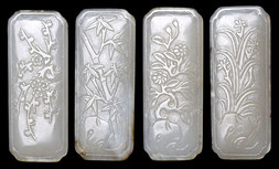 A SET OF 'FOUR SEASONS' PALE JADE PLAQUES
