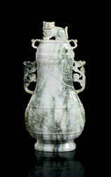 A JADEITE VASE WITH DRAGON HANDLES AND COVER