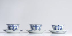 THREE BLUE AND WHITE CUPS AND SAUCERS