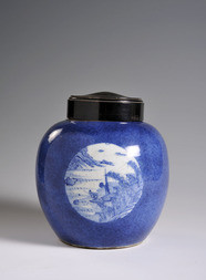 A BLUE AND WHITE  JAR WITH WOODEN LID