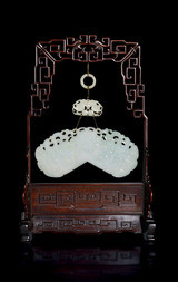 A LARGE CELADON JADE PLAQUE WITH A WOODEN STAND