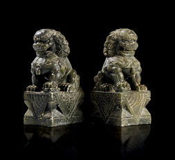 A PAIR OF CARVED SOAPSTONE LIONS