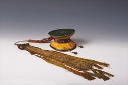 A HUMAN SKULL HAND DRUM (DAMARU) WITH FIVEFOLD SILK HANGING