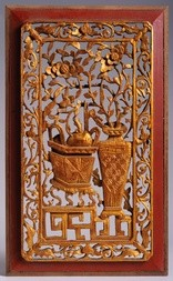A CARVED AND GILT WOOD PANEL