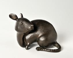 A SMALL BRONZE MODEL OF A RAT