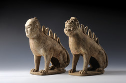 A PAIR OF PAINTED EARTHENWARE EARTH SPIRITS