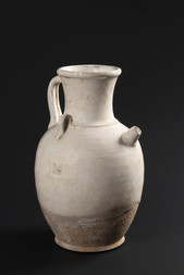 A WHITE GLAZED EWER