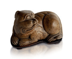 A SOAPSTONE MODEL OF A RECUMBENT FOO DOG