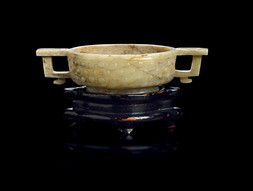 AN ARCHAISTIC CHICKEN BONE JADE CUP WITH HANDLES