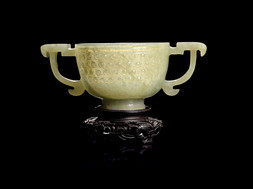 A GREENISH GREY JADE CUP WITH HANDLES