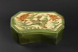 A CREAM, OCHRE, AND GREEN-GLAZED 'PHOENIX' PILLOW