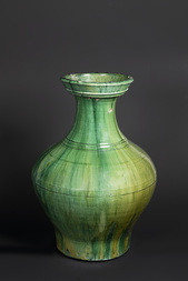 A GREEN GLAZED POTTERY HU FORM VASE