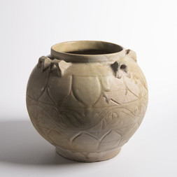 A CARVED CELADON GLAZED HANDLED JAR