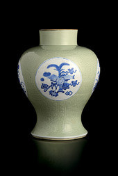 A CARVED CELADON GLAZED UNDERGLAZE BLUE BALUSTER VASE