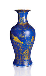 A GILT-DECORATED POWDER BLUE GROUND BALUSTER VASE