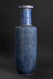 A LARGE POWDER BLUE AND GILT DECORATED ROULEAU VASE