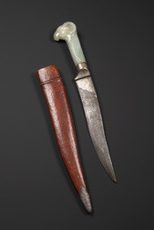 A FINE MUGHAL JADE-HILTED RAM'S-HEADED DAGGER